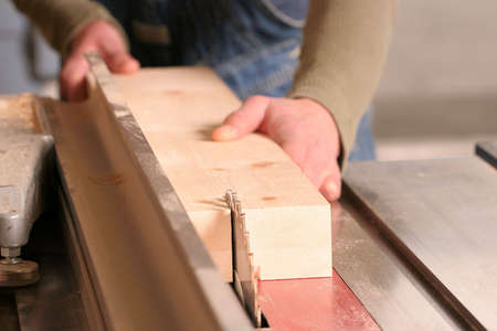 shop skill: A piece of pine being ripped on an industrial tablesaw.