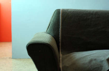 A partial view of an old couch in a colorful room in Mazatlan, Mexico. Stok Fotoğraf