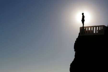 blue sky thinking: A man pepares to jump off a cliff in Mazatlan, Mexico.