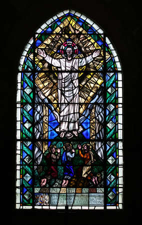 A stained glass window in the famously old Roslyn Chapel, Scotland. photo
