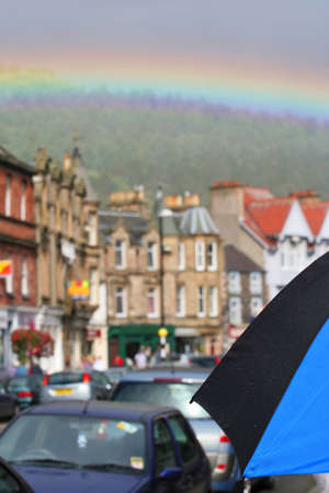 A rainbow arcs over the village of Peebles, Scotland. Reklamní fotografie