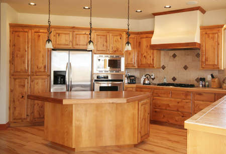 domestic kitchen: A tidy kitchen built with pine and high-end appliances.