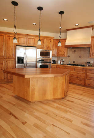 domestic kitchen: A new kitchen in a Montana home.   Maple flooring.