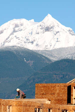 A carpenter works on a new development near Whistler, BC, site of the 2010 Olympic Games. photo