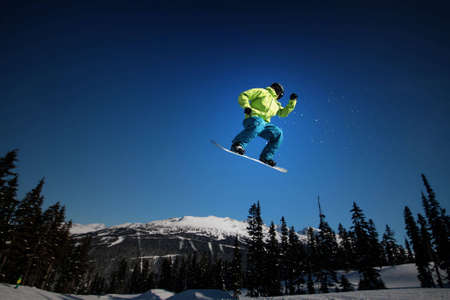 A snowboarder takes flight on Whistler Mountain. Stok Fotoğraf