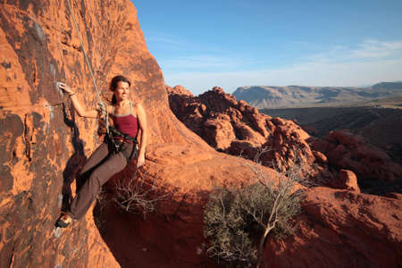 hangs: A climber hangs from her rope to admire the view of Red Rocks State Park.