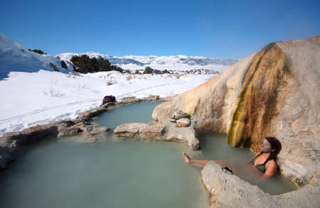 A woman soaks in natural hot springs in California.