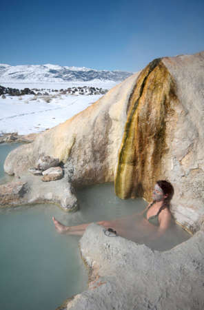 A woman relaxes in a natural hot spring pool in Califonia.