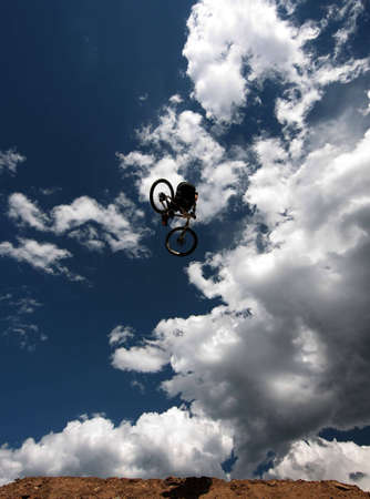 A mountain biker soars over his landing at a competition in Winter Park, Colorado.