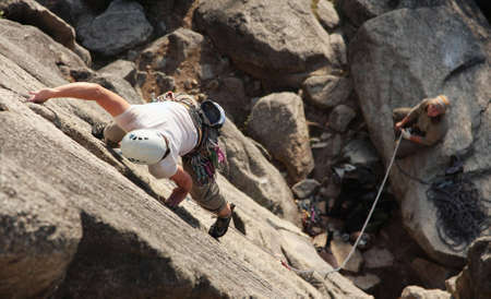 A female climber leads a popular route in Squamish, BC. photo
