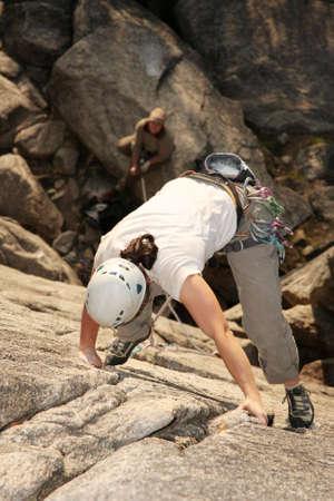 rockclimb: A female climber leads a challenging rockclimb.