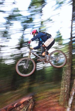 mountin: A skilled mountin biker leaps off of a jump near Hood River, Oregon.