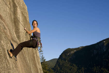 british girl: A fit and attractive girl climbs a granite rock in Squamish British Columbia Canada.