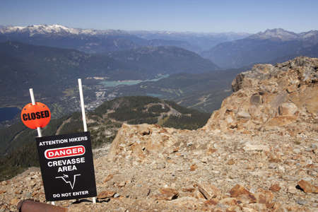 crevasse: A Crevasse Area Sign warning hikers at the top of Whistler.