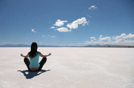 salt flat: A woman practising yoga on the Salinas Grandes in northern Argentina. Stock Photo