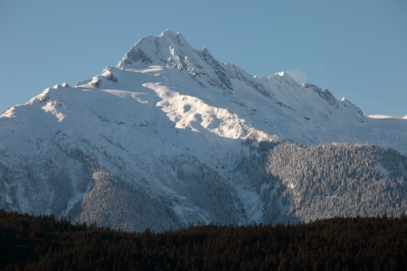 A peak freshly covered in snow in the coastal range between squamish and whistler  photo
