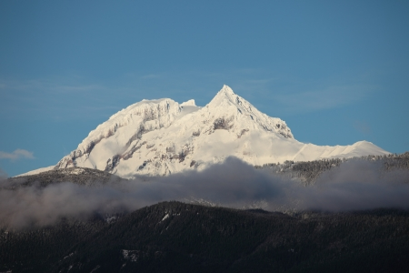 whistler: A peak freshly covered in snow in the coastal range between squamish and whistler