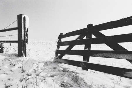 snowlandscape: Wooden fence in snowlandscape Stock Photo
