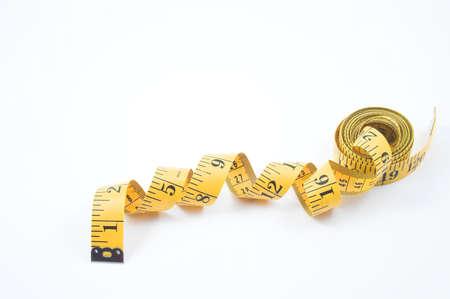 허리의 잘룩 한 선: Tailors Measuring Tape 스톡 사진