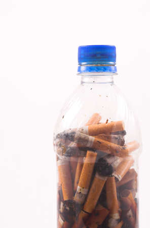 cigarette butts in a bottle photo
