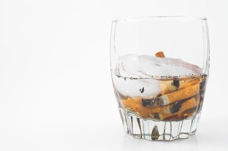 cigarette butts in a glass photo