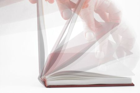 reading material: Book Opening in Motion Stock Photo