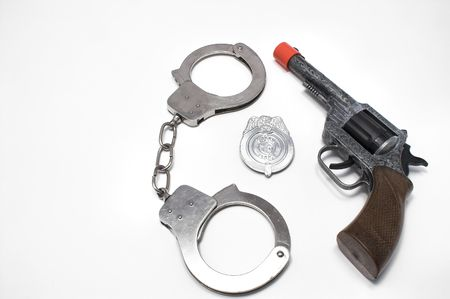 restraints: Badge, Handcuffs and Gun