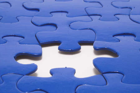 solver: A close-up of a jigsaw puzzle with a missing puzzle piece. Stock Photo