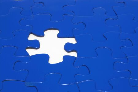 A close-up of a jigsaw puzzle with a missing puzzle piece. Stock Photo - 922989