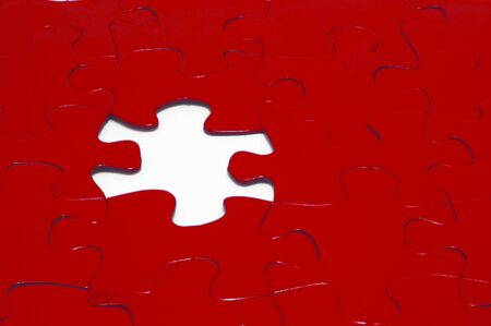 A close-up of a jigsaw puzzle with a missing puzzle piece. Stock Photo - 922991