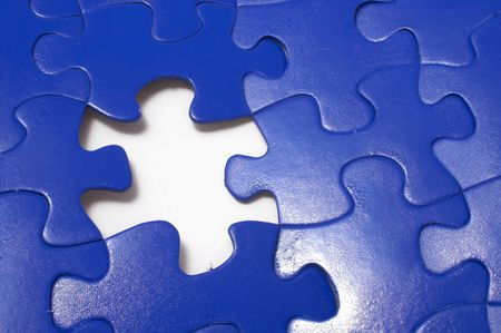 educational problem solving: A close-up of a jigsaw puzzle with a missing puzzle piece. Stock Photo