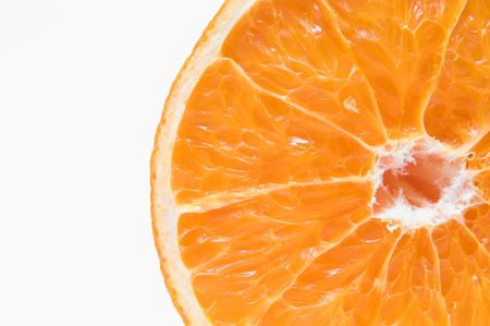 A cross section of a fresh and juicy orange. Imagens