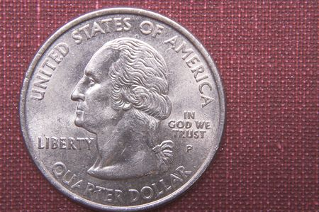 coinage: A United States currency quarter of a dollar.