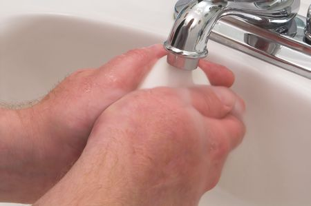 A person washing their hands with soap and water. Stock Photo - 938237
