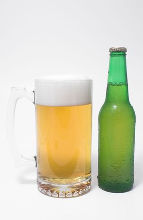 non alcoholic beer: A mug of ice cold beer and a beer in a bottle.