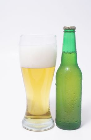 near beer: A pilsner glass of beer and a beer in a bottle.