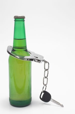 drink responsibly: Drunk Driving Concept - Beer, Keys and Handcuffs