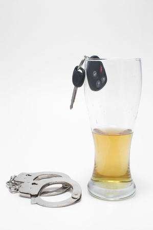 drink and drive: Drunk Driving Concept - Beer, Keys and Handcuffs