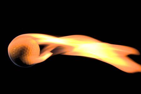 A flaming golf ball rocketing through space. photo