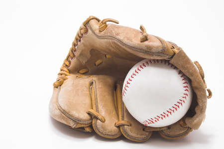 gant de baseball: Un base-ball � lint�rieur de dun gant de base-ball.