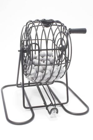 lotto: A bingo game cage with numbered balls. Stock Photo