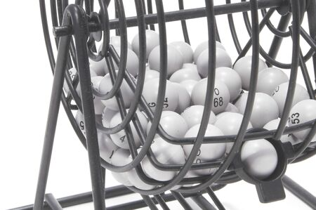 A bingo game cage with numbered balls. Banco de Imagens