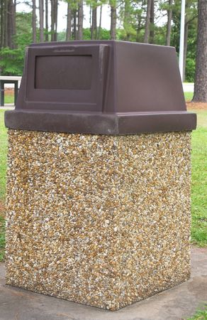A trash can at a public park.
