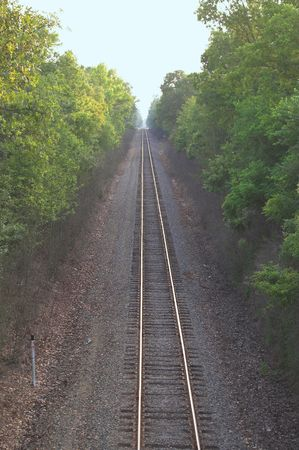 vanishing: Straight train track extending to the vanishing point.