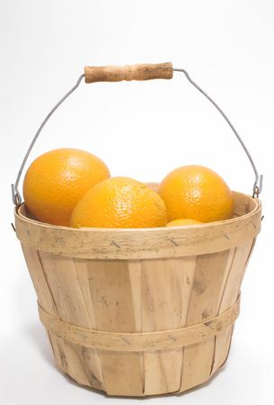 bushel: Delicious oranges in a wooden bushel basket.
