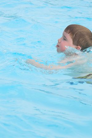 A little boy swimming in a pool. Stock Photo - 1157884