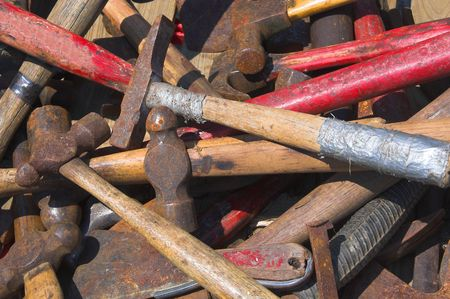 peen: A large pile of assorted old hammers.