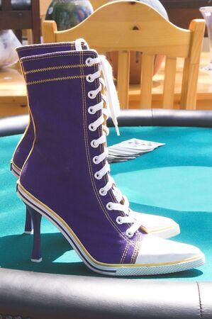 stilletto: A pair of high heel tennis shoes