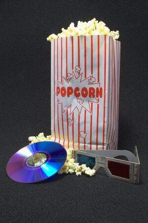 Popcorn and a 3D movie on DVD. Stock Photo - 1173217