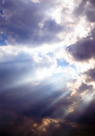 afternoon break: A series of sunbeams shining through storm clouds. Stock Photo